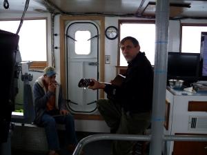 Dan Kidd strumming his banjo as we head to Haiti