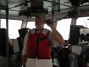 Capt. Kevin Garthwaite telling the crew we are finally heading to Haiti
