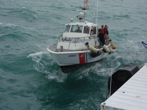 US Coast Guard rafting up to the Sea Hunter off South Miami Beach