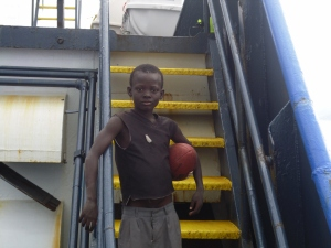 Young Haitian boy aboard the M/V Sea Hunter