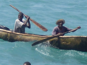 A couple Haitians paddling up the our ship.
