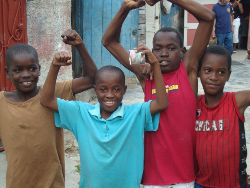 Young Haitian boys posing for the camera. Smiles??