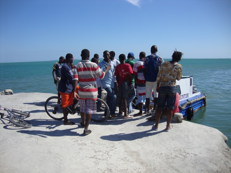 Haitians waiting on the dock when we arrived in Mini Me