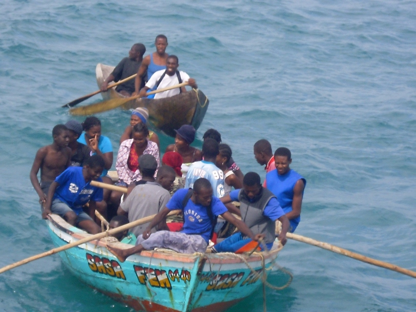 A full boat of Haitians looking to help off load supplies