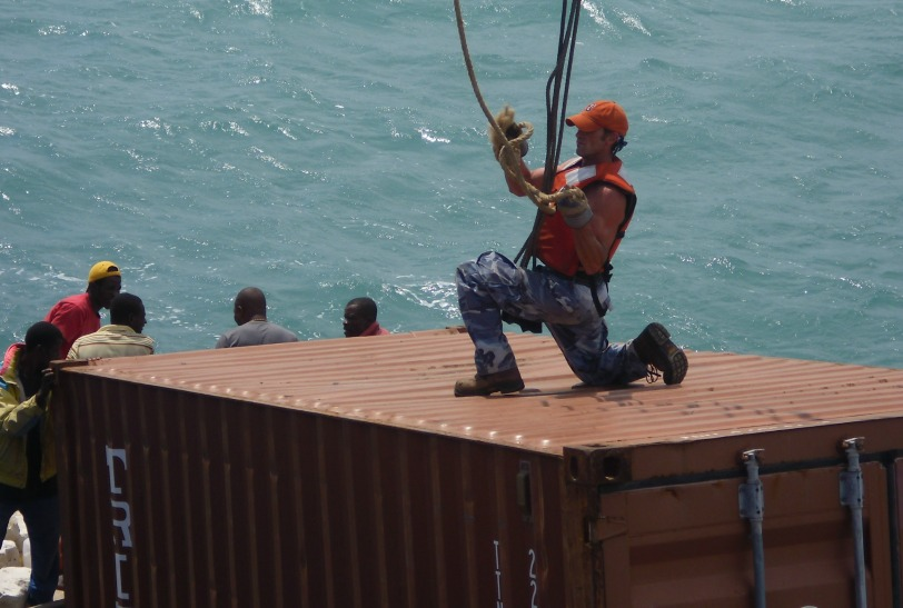 Alex hooking the cables to the 20' container
