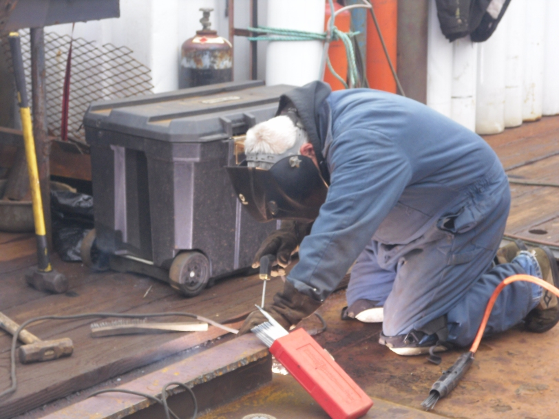 Dave welding on the deck of the M/V Sea Hunter