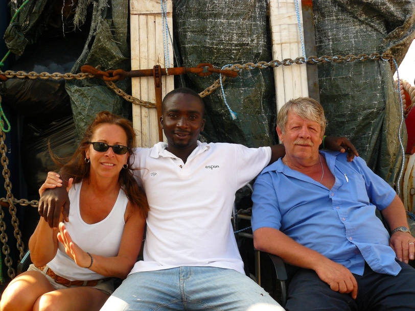 Greg & I with a friend in Haiti
